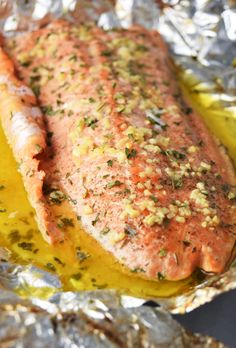Simple steelhead trout recipe baked in foil with garlic, lemon, butter, and fresh herbs. Garlic Butter Steelhead Trout in Foil - Garlic Butter Steelhead Trout in Foil Recipe Steelhead Trout Recipe Baked, Grilled Trout Recipes, Lake Trout Recipes, Baked Trout, Whole Trout Recipes, Baked Fish In Foil, Catfish Recipes, Fish Dishes, Seafood Dishes