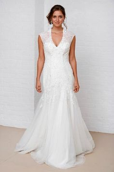 Melissa Sweet bridal gown. Size 12/14. Immaculate sample. Lace over tulle with V-neck, cap sleeves, illusion neckline and back and sweep train. £700.
