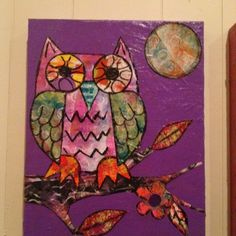 One of my weekend art projects- an owl made from painted papers and outlined in oil pastel then modpodged.