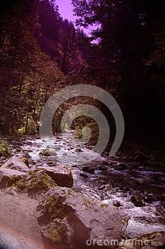 Long exposures of water running between rocks