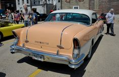 """1956 Buick Roadmaster at Sauk Valley Shifters Car Show and Swap Meet in Sterling, Illinois. I believe this paint color is called """"apricot"""" The '56 Roadmaster looked amazing with its pillarless 4-door..."""
