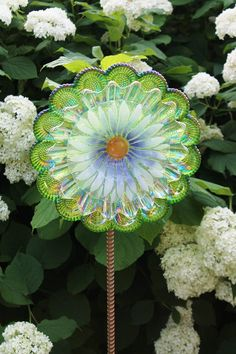 Plate flower garden whimsy i saw these at a craft show for Recycled glass flowers