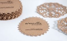 Caroline Armelle used kraft paper, a doily nesting die cut, and a stamp to create her unique business cards