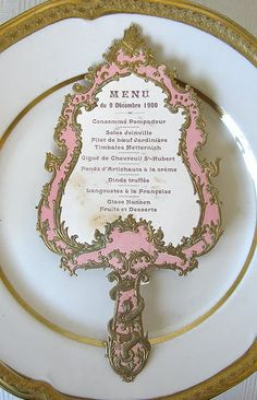 From @parishotel  a 1900 French die-cut menu in the shape of a mirror. Take a look at the detail!