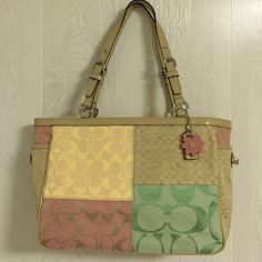 Coach patchwork tote Beautiful soft pastel patchwork tote!! Perfect for spring! All signature patchwork and tan leather trim. Out side pocket on each side with turn lock. Silver hardware. Only carried once Coach Bags Totes