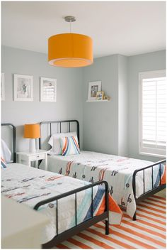 Three years ago we bought our home. It was a nice, basic home. But I have loved transforming it into our own home. We recently finished redoing my son's room, turning it from a room with one toddler bed into a room with two twin beds for my boys to (eventually) share.Beds, bedding, and lighting:…