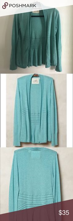 Angel of the North open cashmere blend cardi In like new condition.  Anthropologie Angel of the North Elba cardigan in blue.  Anthro listed the color as blue but it is definitely a teal.  The knitwear line of designer Joanne Williams, who hails from the north of England, a region renowned for its history of traditional knitting. Perfect with everything from shirtdresses to jeans and a tee, we love this super soft, cashmere-kissed cardigan for its throw-on-and-go mantra.  Cotton, nylon…