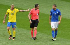 John Guidetti of Sweden disagreeing with referee Viktor Kassi as he speaks to Leonardo Bonucci of Italy during the UEFA EURO 2016 Group E match between Italy and Sweden at Stadium Municipal on June 17, 2016 in Toulouse, France.