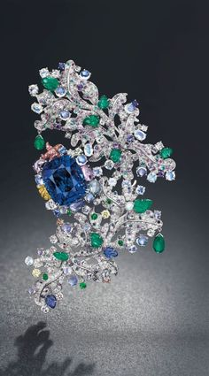 THE UNIQUE SAPPHIRE AND MULTI-GEM 'CÔTE D'AZUR' BROOCH, BY ANNA HU LOT 280 SALE 1400 PRICE REALIZED CHF4,197,000 ($4,569,684) ESTIMATE CHF2,350,000 - CHF3,300,000 ($2,557,823 - $3,591,837) Sale Information SALE 1400 — MAGNIFICENT JEWELS 12 November 2013 Geneva BUY CATALOGUE Lot Description THE UNIQUE SAPPHIRE AND MULTI-GEM 'CÔTE D'AZUR' BROOCH, BY ANNA HU Centering upon a cushion-shaped sapphire, weighing approximately 58.29 carats, to the pavé-set diamond floral branch decorated with…