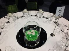 Celebration Events - fishbowl centre piece - coloured gel with flower heads....LED lights added for the evening. Gel available in lots of colours x