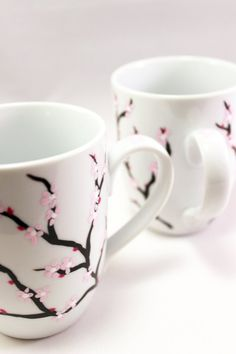 Hand painted coffee mugs with cherry blossoms, painted cherry blossom mugs, flower coffee mugs, set Painted Coffee Mugs, Hand Painted Mugs, White Coffee Mugs, Painted Plant Pots, Painted Vases, Painted Ceramics, Cherry Blossom Painting, Cherry Blossoms, Sharpie Paint