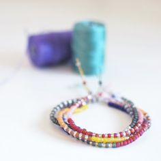 Make an easy adjustable seed bead friendship bracelet. They look fab as part of a bracelet stack