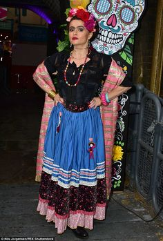 Eccentric: The 49-year-old brought some of her own eccentric style to the costume...