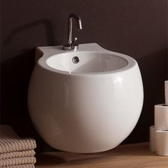 Features:  -Wall mounted bidet.  -Planet collection.  Product Type: -Wall mount bidet.  Bowl Type: -Round.  Finish: -White.  Primary Material: -Vitreous china.  Nozzle Placement: -Posterior.  Spray Di