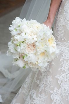 Bride's white floral bouquet at southern garden wedding at First Baptist church in Charleston, South Carolina, photography by Leigh Webber