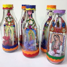 A Mexican shrine in a bottle conveys the admiration of the Virgen de Guadelupe through color, glitter, candles, flowers and shine! The goodies inside are different on both sides. Each bottle is one of Catholic Crafts, Catholic Kids, Catholic Religious Education, Mexican Crafts, Mexican Folk Art, Mexican Stuff, Faith Crafts, Bible Crafts, All Saints Day