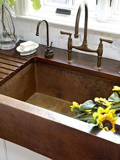 Love a copper farmhouse sink with a  wood grooved countertop for drainage