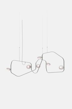 This twisting chandelier by New York studio Rich Brilliant Willing is designed to be read backwards and forwards like a palindrome. Cool Lighting, Lighting Design, Luxury Lighting, Lighting Ideas, Light Art, Lamp Light, Pendant Lamp, Pendant Lighting, Wire Lighting