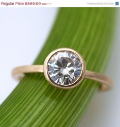 Moissanite Facets .8 Carat Modern Engagement Ring. $680.00, via Etsy.