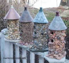 7. Transform a plain birdhouse with stones | 17 Charming Garden Art DIYs