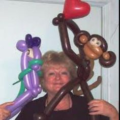 Monkey balloon. I love the two toned face. Like the bent arms - and heart is cute but not needed