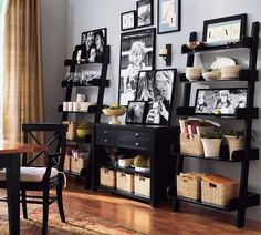 Another photo of these shelves as dining room storage... love the black with white dishes!!!