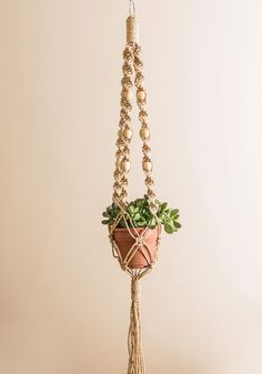Macrame for Each Other Hanging Decor. This retro-inspired macrame fixture fits perfectly in with your decor - so of course you were drawn to it! #tan #modcloth