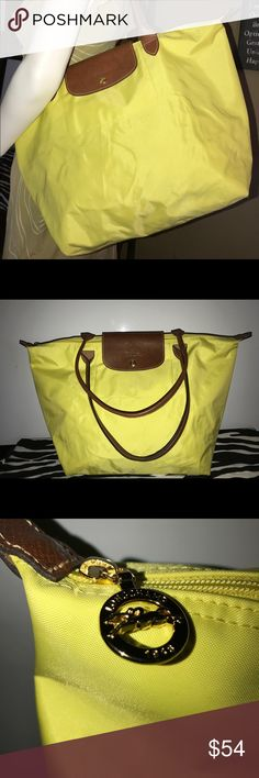 Longchamp Le Pliage Large Bright Yellow Tote Bag Practical Large Longchamp Tote In Good Preowned Condition   • Top Zip Closure + Clip  • Brown Leather Handles • Good Preowned Congratulations  • Minor Signs Of Wear  • No Holes or Tears  • Bundle 3+ & Get 15% off + Free Shipping  * Bundle 2 of at least $50 & Get 5% off + Free Shipping  * Please remember my Poshmark fee is 20% when submitting your offer.   * Fastest Shipper In The South  * 100% Satisfaction Guaranteed Longchamp Bags Totes
