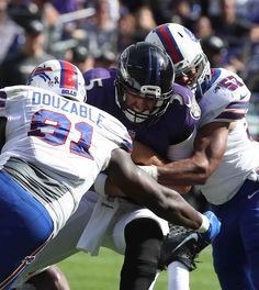 Bills-Ravens:    Monday, September 12, 2016  -  Buffalo Bills defensive tackle Leger Douzable (91) sacks Baltimore Ravens quarterback Joe Flacco in the fourth quarter.  -   James P. McCoy / Buffalo News News Sports Photographer James P. McCoy captured outstanding images from the Bills' season-opening loss in Baltimore. Here are our favorites: