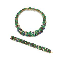 "FROM THE ESTATE OF THE LATE GUNTHER SACHS Gem set and diamond demi-parure, ""Tutti Frutti"", Cartier Comprising: a necklace and a bracelet, the necklace designed as a series of carved emeralds and sapphires, accented with cabochon rubies and brilliant-cut diamonds, some of yellowish tint, the bracelet of matching design"