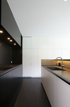 *kitchen design, modes, minimal interiors, black and white look* - Love the lighting and the cabinets' colors contrast.