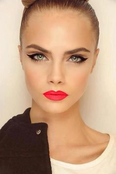 On this Makeup Monday, I'm all about the update on the classic cat eye. For a cleaner and sharper look, stretch the wing out just a tad longer and add liner on just the outer half of the lower lash line. Don't add any shadow and add minimal mascara. Then, for a real pop, go for a bright coral lip!
