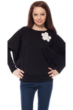 Black knitted bat-type blouse. The blouse is with decoration-flower on the shoulder.