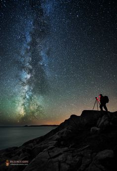 Astrophotographer Mike Taylor sent SPACE.com this stunning image showing the bright band of the Milky Way galaxy over Maine's rugged Bold Coast. The photo captures the Milky Way's brilliance colleague Garrett Evans sets up his gear. [Read the Full Story]