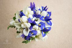 LOVE! This is totally my bouquet. Blue Iris, Calla Lillies and White Roses for filler. YES PLEASE!