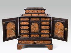 Kabinettschrank Meister mit dem ornamentierten Hintergrund, Eger, Mitte 17. Jh. Reliefintarsien aus verschiedenen Holzarten; 80 × 63,5 × 37,5 cm EUR 30.000-60.000