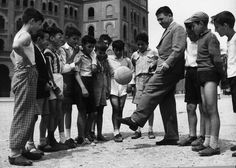What a nice photo - Real Madrid star Ferenc Puskas juggles for a group of kids
