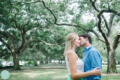 Romantic Downtown Charleston engagement photos in The Battery Park // White Point Gardens // by Charleston engagement photographers Aaron and Jillian Photography