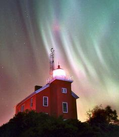 All the illumination you need: lighthouse and Northern Lights! Marquette, MI