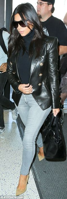 Kim Kardashian and Kanye West are sleek in leather as they jet to San Francisco after she reveals he sings daughter North bedtime lullabies | Daily Mail Online