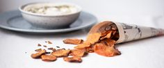 Oven Baked Sweet Potato Chips are the perfect healthy snack when you're craving for something crunchy and satisfying. Try them with savory or sweet spices!
