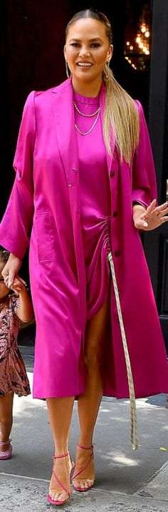 f80e3c6c9a5 Who made Chrissy Teigen's pink coat, jewelry, and clear sandals? Coat  -Claudia
