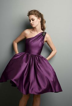 Brides.com: Bridesmaid Dresses for Destination Weddings. Style F15409, one-shoulder, asymmetrically draped bridesmaid dress in matte crepe with grosgrain sash and back-bow detail in plum, $149, David's Bridal See more David's Bridal bridesmaid dresses.