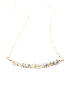 Teeny, tiny gray and cream saltwater pearls on delicate chain. By Kahili Creations of Hawaii...