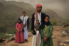 This shot shows two child brides in rural Yemen with their husbands. Tahani, the girl in pink, is eight; her husband Majed is 27. Ghada, in green, is also eight, while her husband Saltan is 33. -- Child marriage is not an inevitable outcome of poverty. It is a practice bolstered by cultural attitudes, religious beliefs and scripture, and problematic laws.