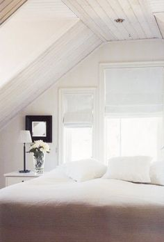 I love white on white.  The architecture of this room makes the room so cozy.