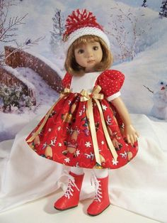 """Treasured Doll Designs Presents:A Holiday Treasure for 13"""" Effner Little Darling. DRESS: Fashioned from a charming cotton print of frolicking reindeer with white pin dot for the bodice and sleeve bands and red polka dot for the sleeves."""