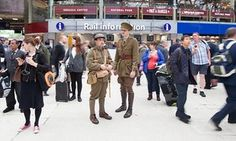 Soldiers stand in Waterloo station