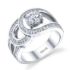 Brides.com: Unique Engagement Ring Settings. 18k white gold ring with round diamond center stone,