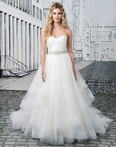 Justin Alexander wedding dresses style 8779 A striking gown for a modern princess. Layers of tulle will float regally from the center aisle to the dance floor, and a sweetheart bodice of silk dupion with a beaded belt add just a touch of sparkle to this Justin Alexander favorite.